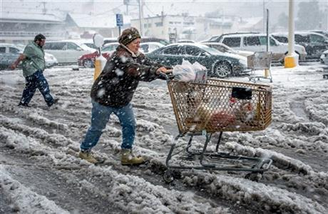 GREAT PLAINS STORM BRINGS BOTH SNOW, TORNADOES