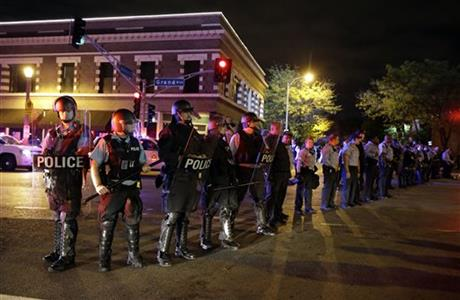 Angry protesters yell at riot police in St. Louis