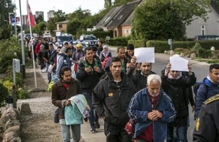 Austrian leader say accept migrants or pay