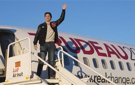 Harper battles Liberal icon's son in Canadian elections