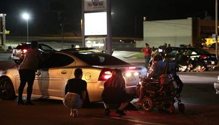 Car hits protester in Ferguson, shots ring out