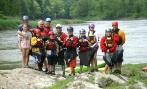 On Family Whitewater Weekend, some WILD kayakers, including Stow's Gareth Carey (center) pose before conquering the White River in VT. Students can participate in longer distance weekend adventures, as well as after school adventures nearby.                                                                                                                                                                                                                                               Courtesy