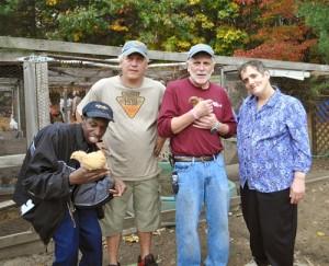 "Pictured from left are TILL member Mark, ""Farmer Frank"" Gesualdi, John Stevens, Special Programs Director for TILL and TILL member, Debbie.                    Nancy Arsenault"