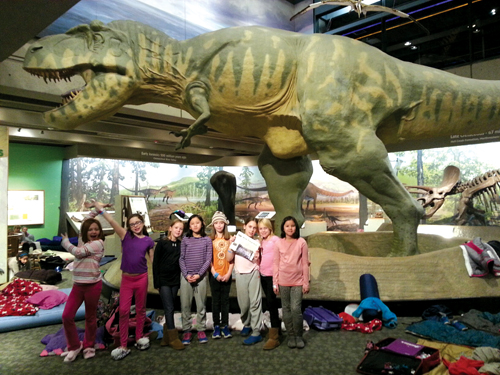 Troop #75253 had a fabulous time at the Museum of Science sleepover!  The girls were kept very busy building sustainable cities, exploring the museum, and watching iMax, lightning, and planetarium shows.  From the left:  Avery Cullen, Jennifer Kearney, Zenna McIsaac, Evelyn Yee, Linnea Grundy, Penny Strauss, Carlin Krisher, and Lauren Yee.