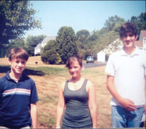 Neighbors and friends (l-r) Brendan Aylward, Leah Tepper, and Will Hurley pose in their neighborhood during their school days.                                                               Courtesy