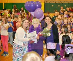 Gladys McClellan with teachers Maura Sheehan(left) and Lisa Wallat (right) at a recent student-driven All School Assembly at Center School honoring Gladys for her many hours of volunteer work at the school.