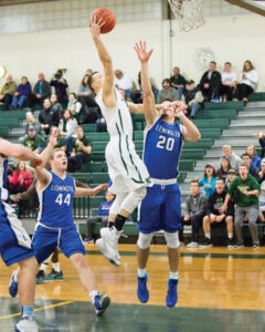 Nashoba junior Trevor Manyak (#5) makes the jump against Leominster on Jan. 12.  The Chieftains lost 58-48, only their second loss of the season.                SusanShaye.com