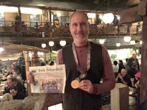 Chris Beck on Sunday Feb. 28  at the restaurant Gonpachi in Tokyo (the restaurant that was the inspiration for the fight scene in the movie Kill Bill).  Chris is wearing his Tokyo Marathon Medal from finishing earlier in the day. Chris said his next and last stop in his marathon series is Boston in April.