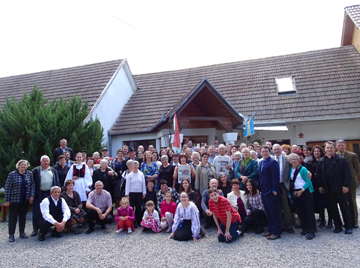 Two different editions of the Stow Independent and 31 members of the First Parish Church Unitarian Universalist of Stow and Acton with members of their sister  Church in Olasztelek, Transylvania, Romania after the Sunday, April 24th, service where Rev. Tom Rosiello preached and the FPC choir sang.  This was followed by a buffet of Transylvanian and Hungarian foods, including amazing homemade desserts, on the lawn under the apple trees next to the Olasztelek Church. A moving and learning experience for all.