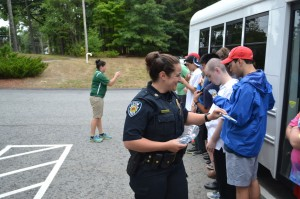 Stow Police Officer Cassandra Ela gifts each student with their own Stow Police patch.  Ann Needle photo