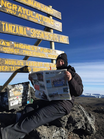 Robert Bell, recently featured in an article about his journey to the top of Mt. Kilimanjaro, is seen here at the summit, elevation 19,341 feet. Kilimanjaro is the highest mountain in Africa and the highest free-standing mountain in the world.  Thanks to Mr. Bell for taking us to the top to reach new heights!