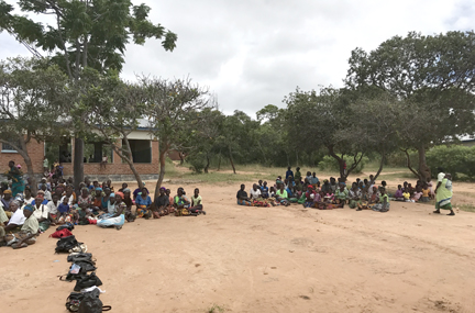 A line of patients waiting to be seen at a rural outreach clinic in Malawi, Africa Courtesy Don Hangen