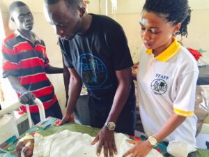 Daniel and Sharon Okabe praying for sick children at Mbale Hospital