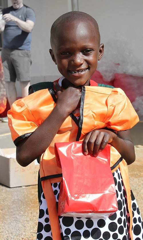 Child clutching gifts.