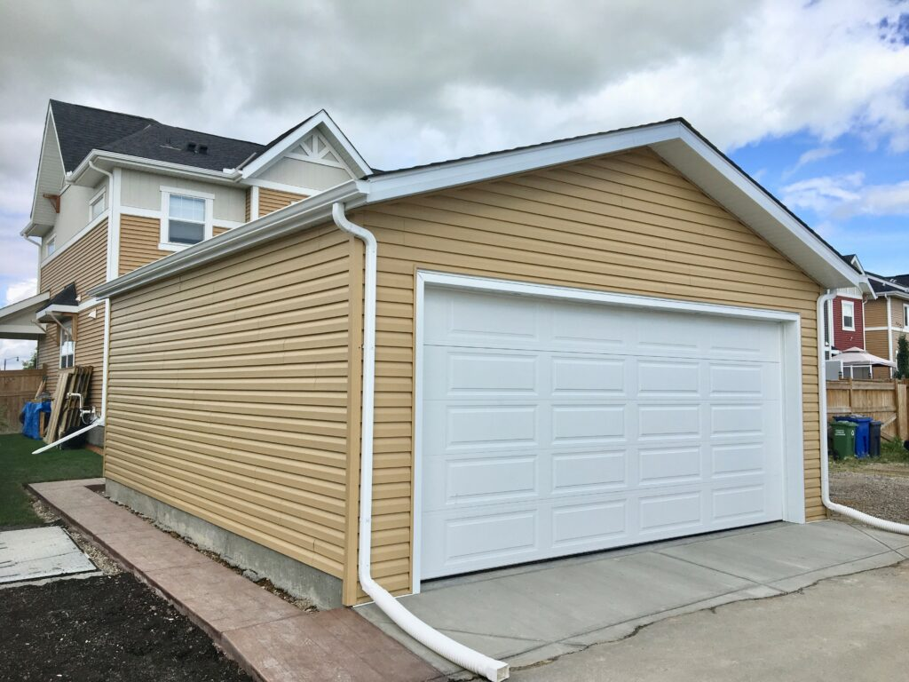 Alley Garage For A New Build with Siding