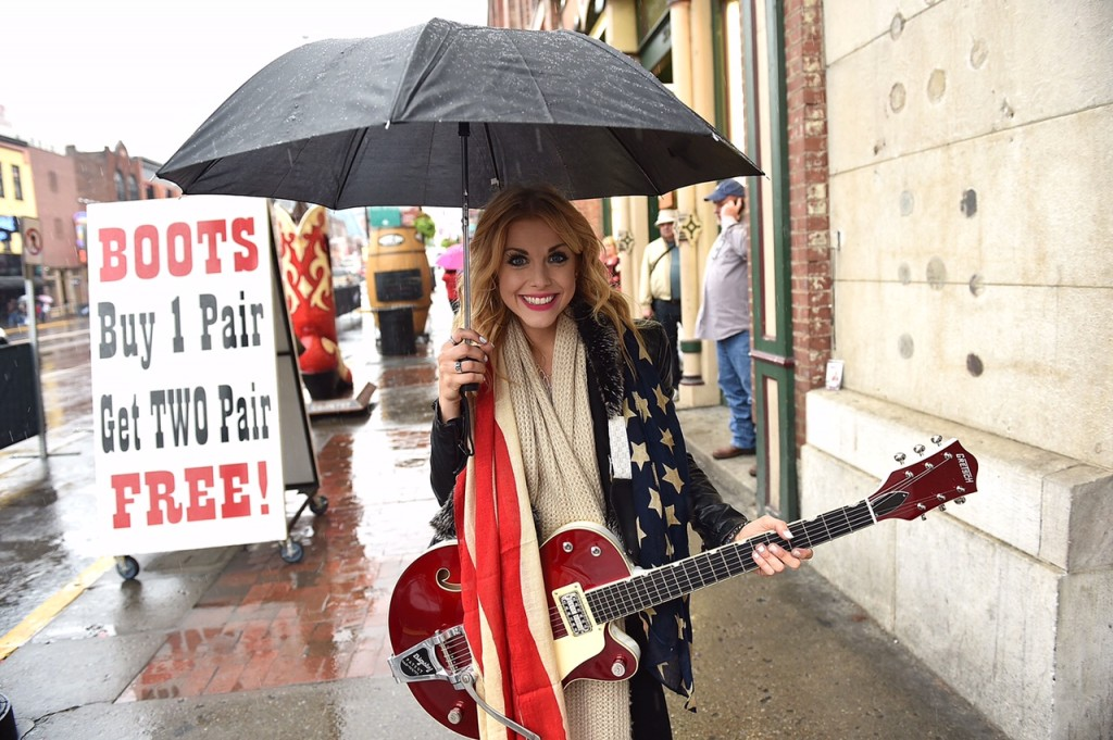 Lindsay Ell Busking on Broadway in the rain. Photo Credit John Shearer