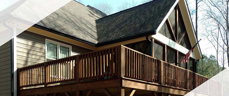 Wrenn Home Improvements built this custom deck that wraps around a screened porch