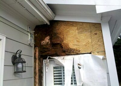 Picture shows wood rot around a back door