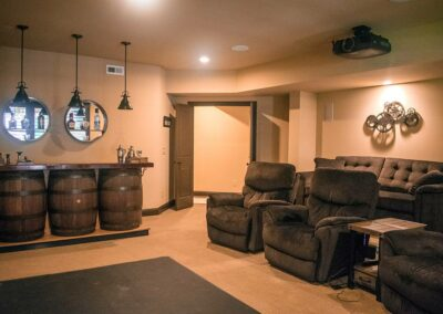 theater room and bar area in basement space
