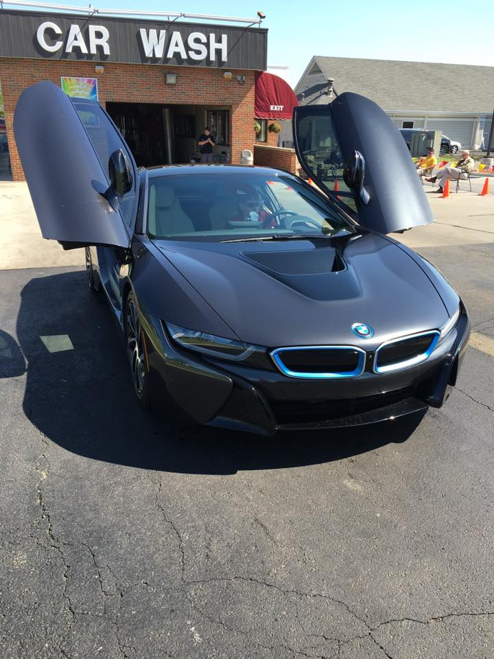 A BMW i8, a hybrid electric sports car, after a vacuum and wash; we're performing the final touches.