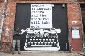 Anonymous Street Artist WRDSMTH in front of one of his works in DTLA