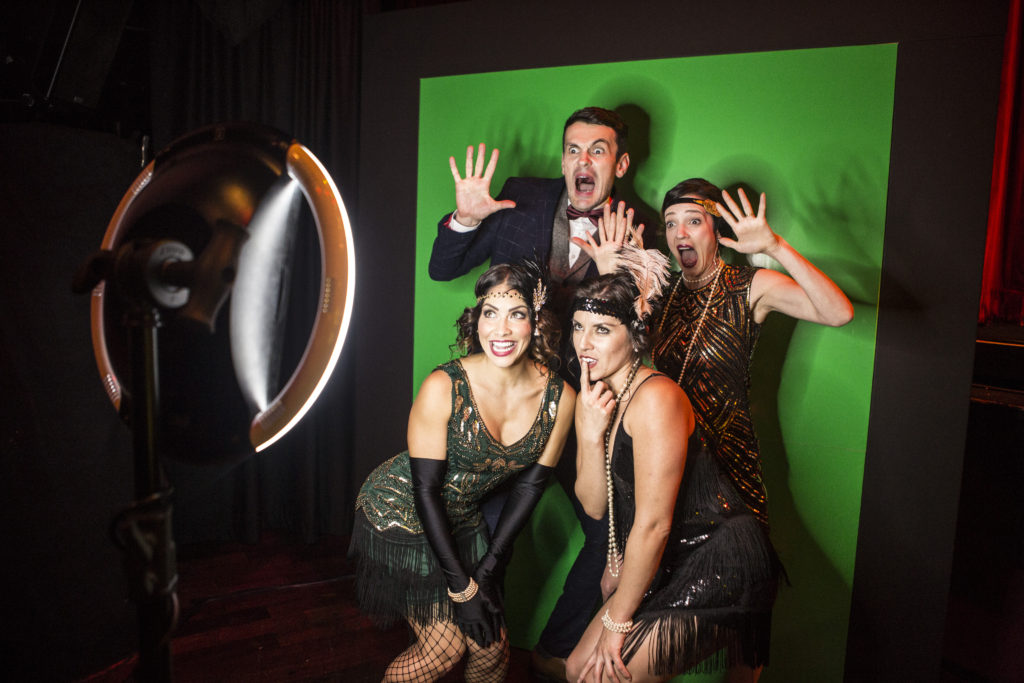 Guests enjoy the Curtis J. Moore Photography photo booth Harmony Gerber