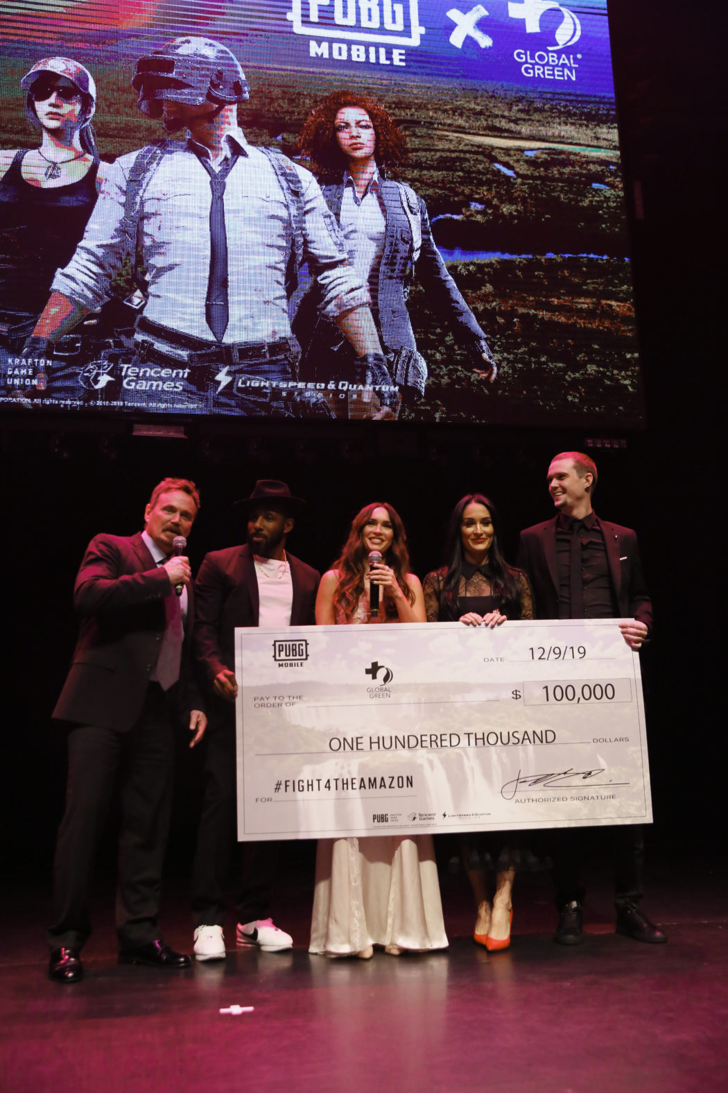 Megan Fox presents PUBG MOBILEs donation to Global Green with her Team Foxy teammates Stephen Twitch Boss Nikki Bella and Pickles Ryan Miller