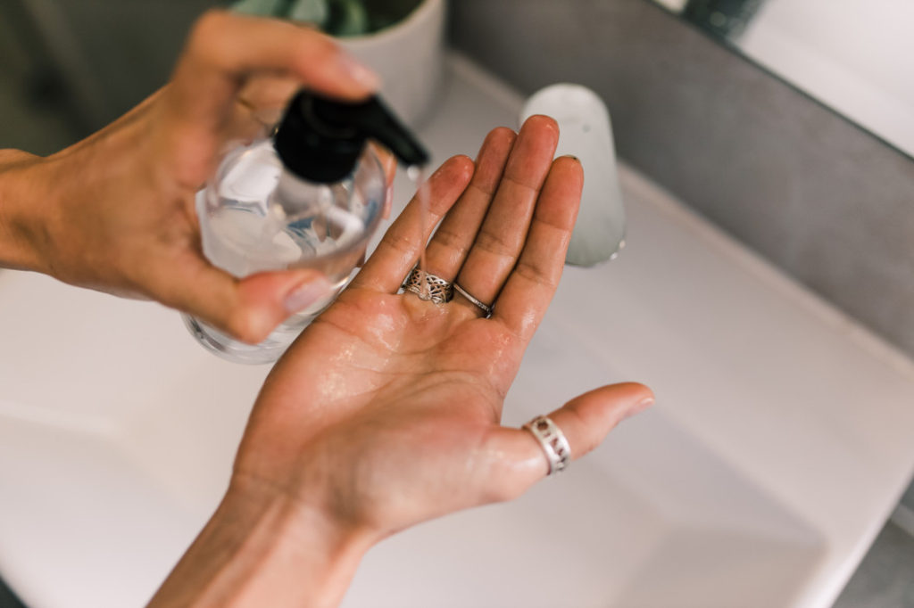 woman using hand sanitizer t20 WgO8og