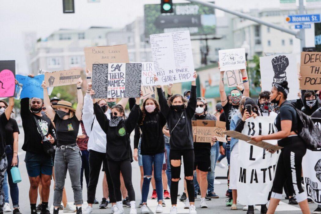 diverse activism peaceful civil unrest minority marginalized protest social justice injustice change t20 drpeP3