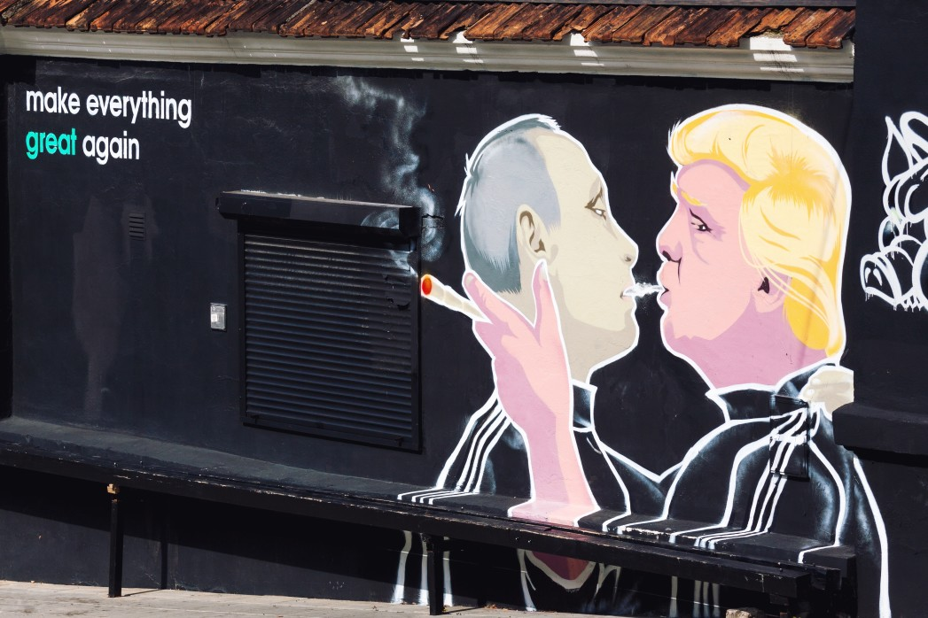 mural artwork on the wall of a barbecue restaurant in vilnius
