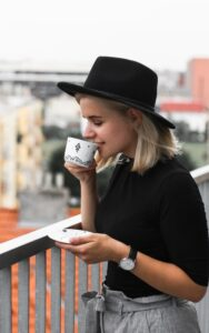 woman sipping coffee on a balcony