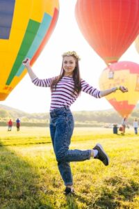 woman in front of hot air balloon