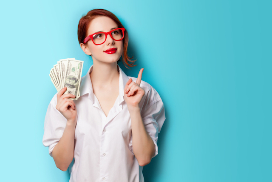Young Millennial woman with money