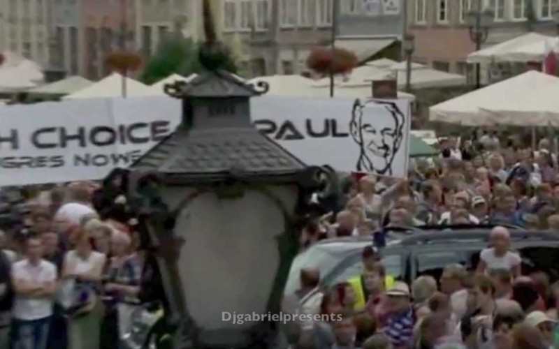 Poland Greets Romney With Huge Ron Paul Banner