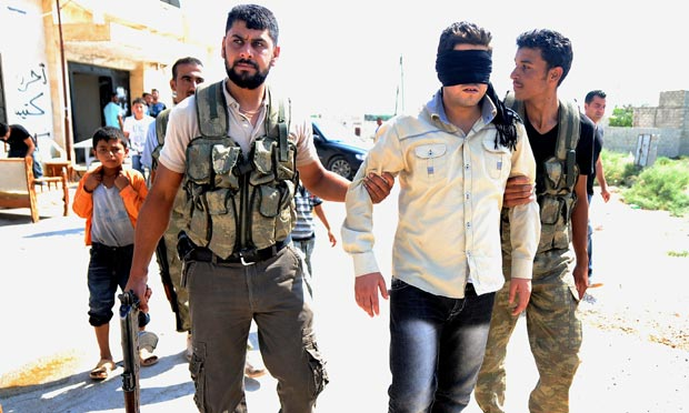 Syrian rebels arrest a man who is claimed to be traitor at an old military base near Aleppo