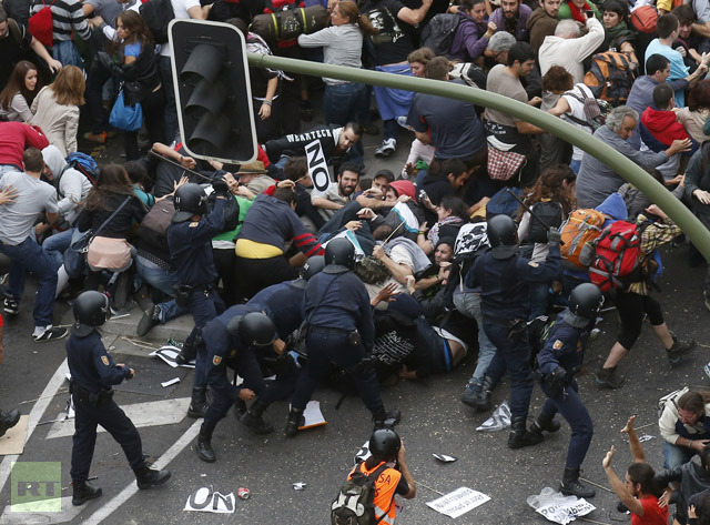 Riot police clash with protesters close to Spain's Parliament during a demostration in Madrid