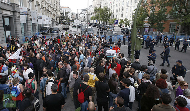 Protestors gather close to Spain's Parliament ahead of a demonstration in Madrid