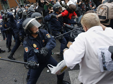 Police charge demonstrators outside the the Spanish parliament in Madrid