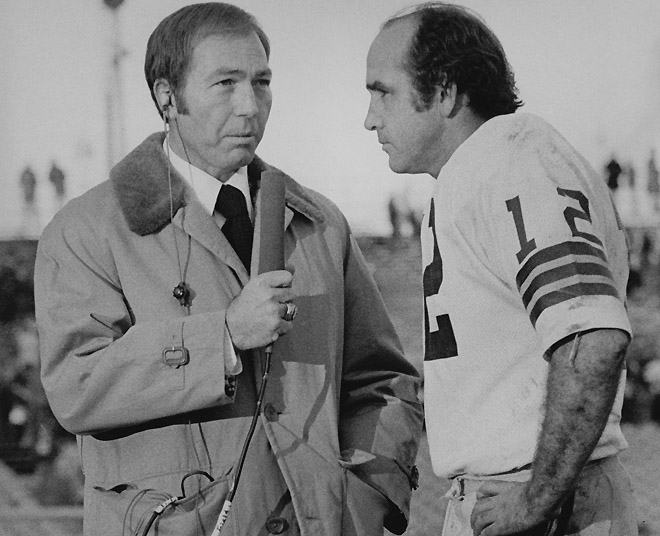 Former Packers quarterback Bart Starr, now a television commentator, interviews current Packers quarterback John Hadl. Dated 1974