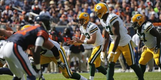 Packers Quarterback Aaron Rodgers takes a snap against the Bears