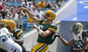 Sep 11, 2016; Jacksonville, FL, USA; Green Bay Packers quarterback Aaron Rodgers (12) throws a touchdown pass to wide receiver Davante Adams (not pictured) against the Jacksonville Jaguars in the second quarter at Everbank Field. Mandatory Credit: Rick Wood/Milwaukee Journal Sentinel via USA TODAY NETWORK ORIG FILE ID: 20160911_gma_usa_118.jpg