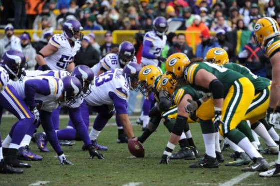 The Green Bay Packers line up against the Minnesota Vikings.