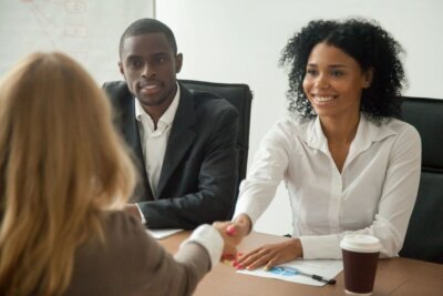 Black woman and man makeing a deal with white female client on Techfullypro.com