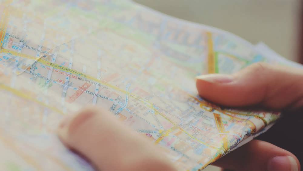 map in hand of man