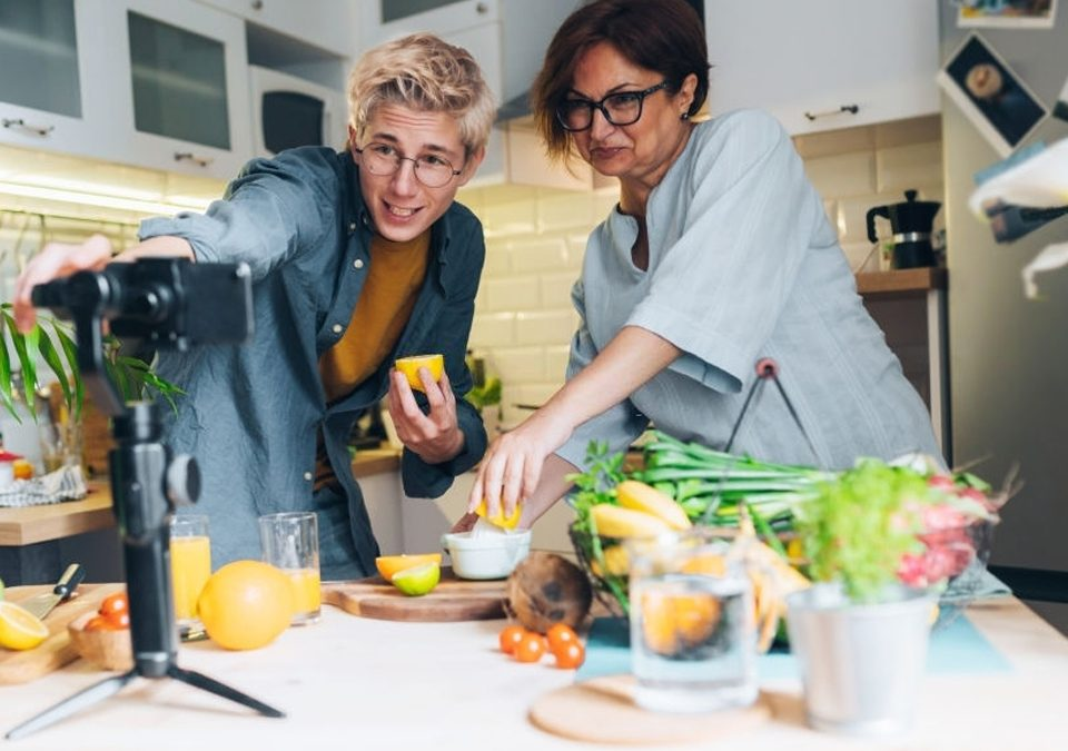 a mother with her son are making video cooking training