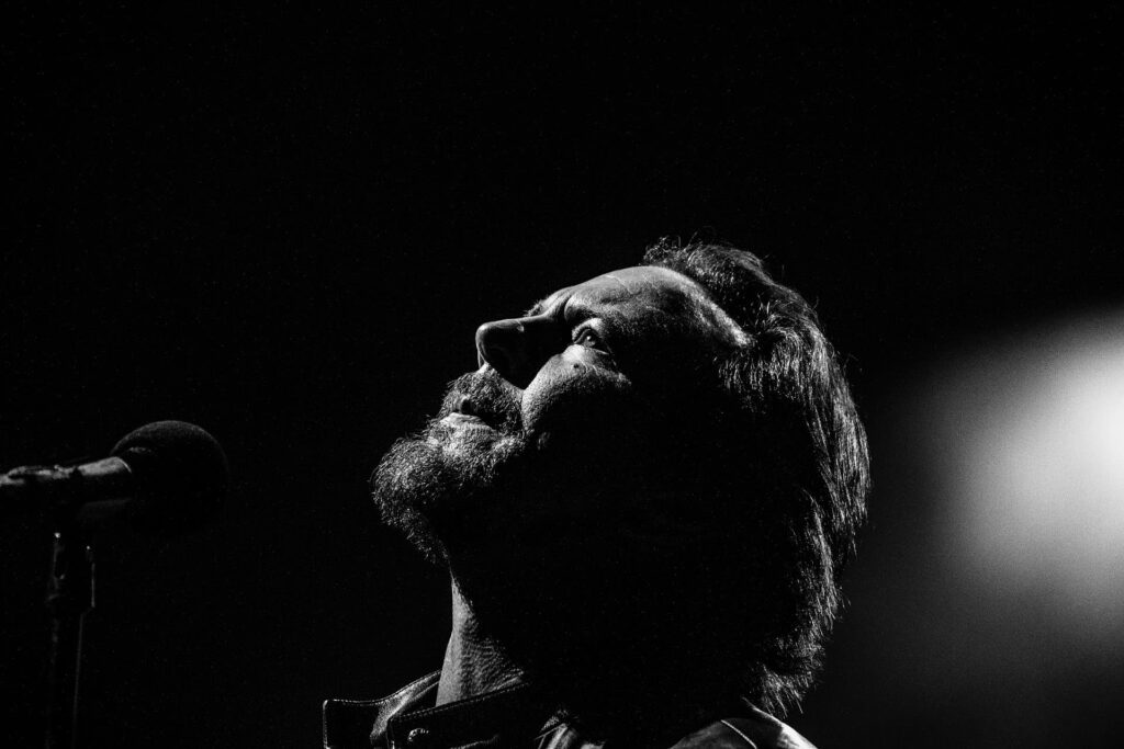 Concert Editorial of Eddie Vedder of Pearl Jam performing at Fenway Park by Boston based photographer Greg Caparell