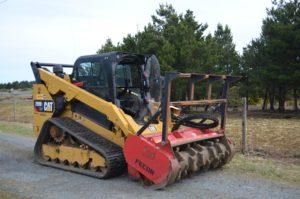mulching mower head on tracked skid-steer