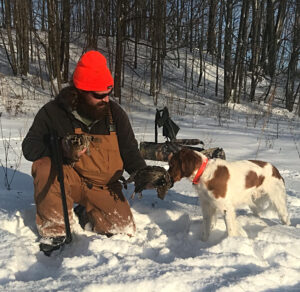 landpass man feeding bird to dog