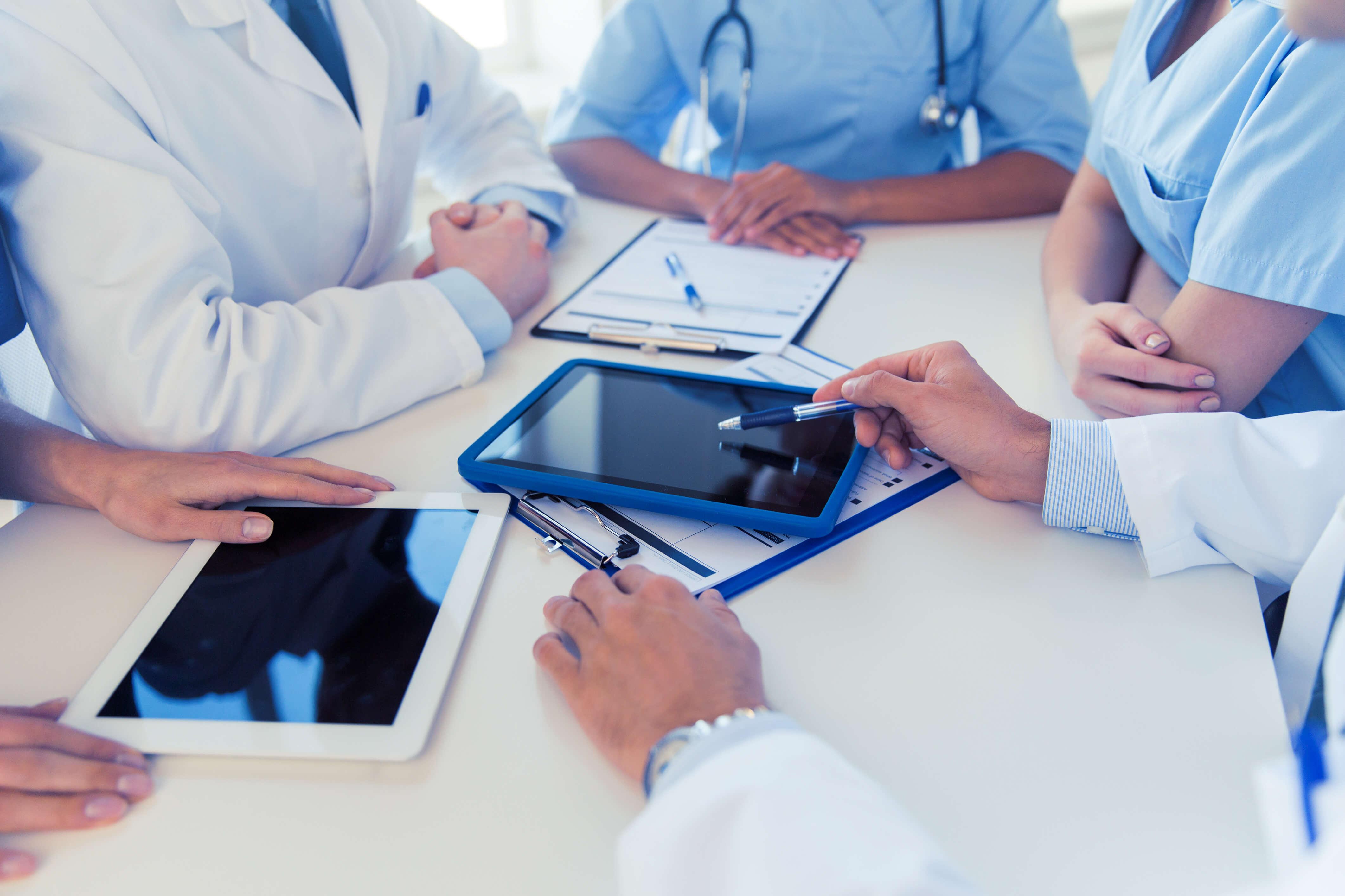 doctors tablet hands pen stethoscope medical nurse triage call