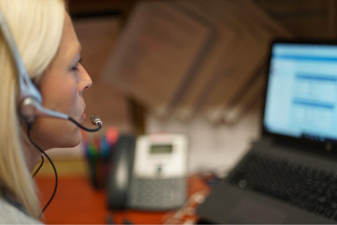 registered nurse blonde computer on medical call